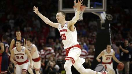 Wisconsin forward Sam Dekker celebrates after Wisconsin beat