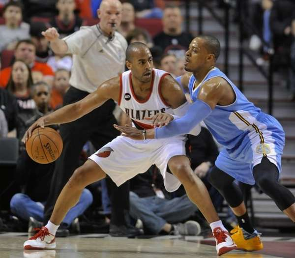 The Denver Nuggets' Randy Foye, right, defends against