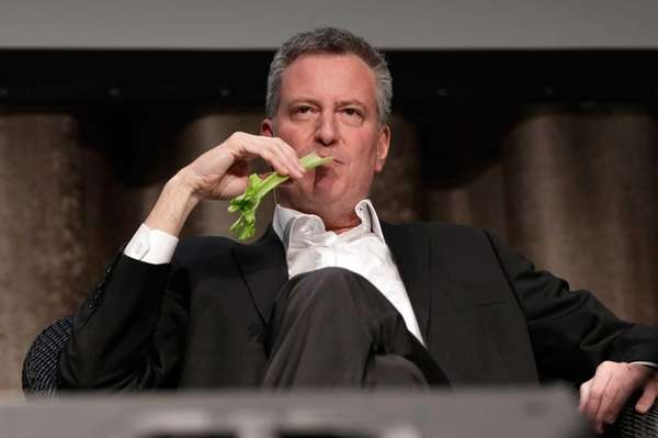 New York Mayor Bill de Blasio performs during