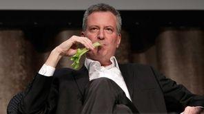 New York Mayor Bill de Blasio performs during