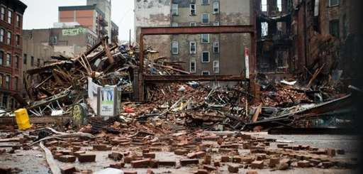 A pile of debris remains at the site