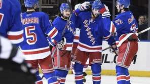 New York Rangers center Derick Brassard, second from
