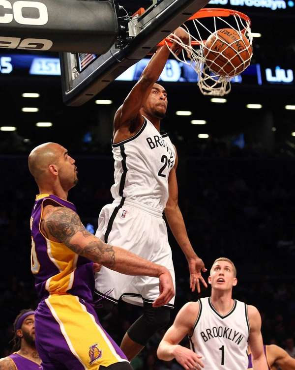 Brooklyn Nets shooting guard Markel Brown #22 dunks