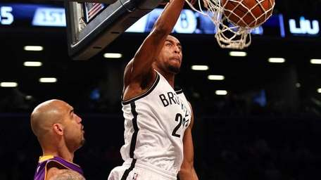 Brooklyn Nets shooting guard Markel Brown #22 dunks