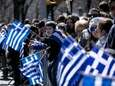 Greek flags fly along the parade route during