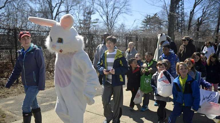 The Easter bunny leads kids on an Easter
