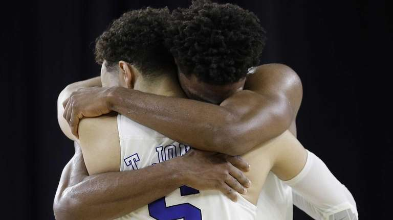 Duke's Justise Winslow and Tyus Jones (5) celebrate
