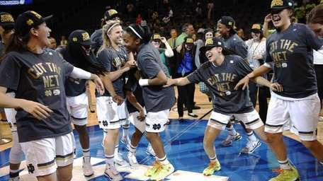 Notre Dame celebrates after a regional final against