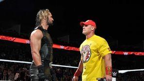 Seth Rollins, left, with John Cena, won the