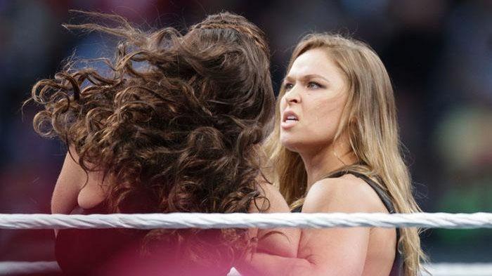 UFC women's bantamweight champion Ronda Rousey, right, roughs