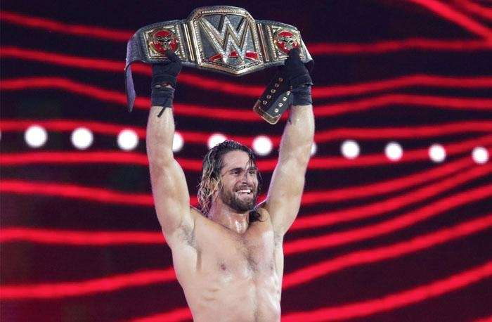 Seth Rollins celebrates winning the WWE World Heavyweight