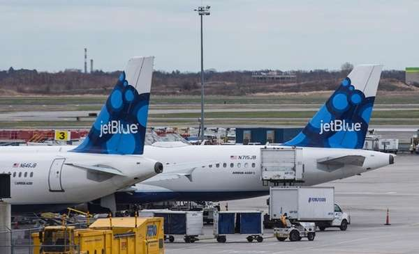 JetBlue planes sit at their gates at John