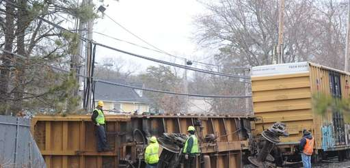 The scene of an overturned freight train car,