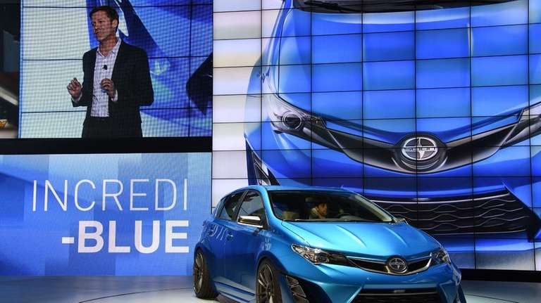 Scion vice president Doug Murtha unveils the five-door