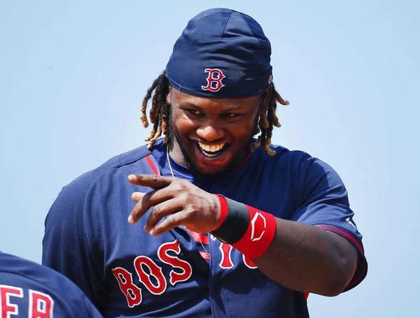 Boston Red Sox shortstop Hanley Ramirezokes with a