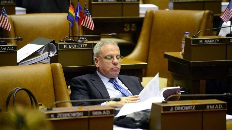 Assemblyman Jeffrey Dinowitz (D-Bronx) reads over bills from