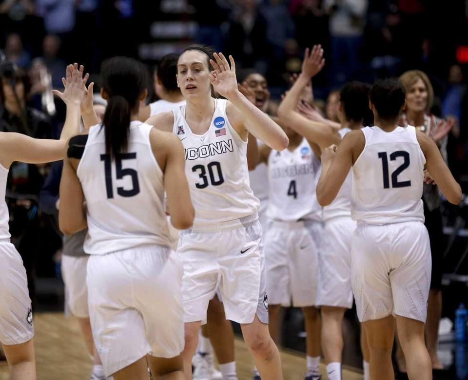Connecticut's Breanna Stewart and teammates celebrate their win