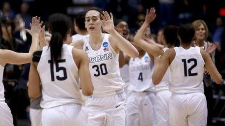 Connecticut's Breanna Stewart and teammates celebrate their win