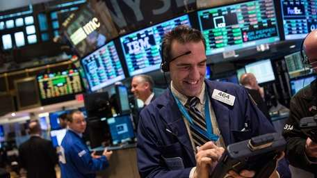 A trader works on the floor of the