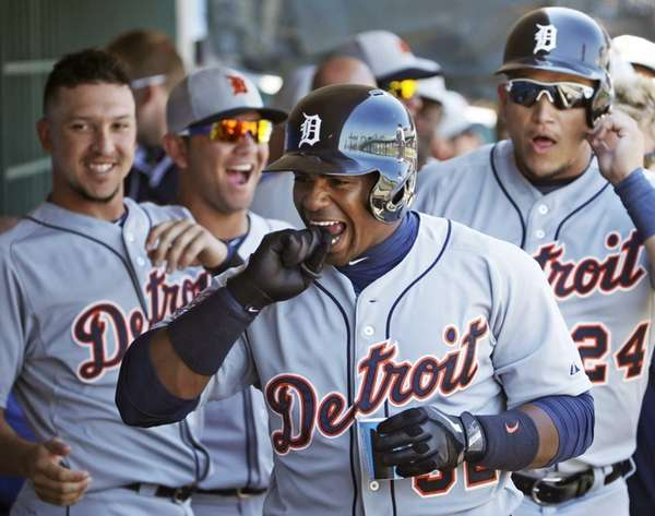Detroit Tigers teammates laugh as Yoenis Cespedes (52)