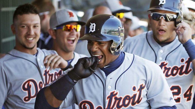 Detroit Tigers teammates laugh as Yoenis Cespedes (52)