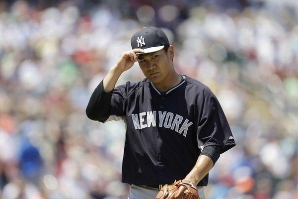 New York Yankees starting pitcher Masahiro Tanaka walks