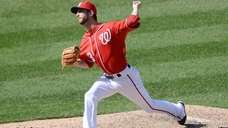 Washington Nationals relief pitcher Jerry Blevins (13) delivers