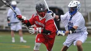 Syosset's Alex Concannon, left, gets pressured by Port