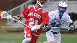 Syosset's Mattthew Benus, left, maneuvers for a shot