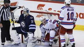 New York Rangers' Chris Kreider celebrates with teammate