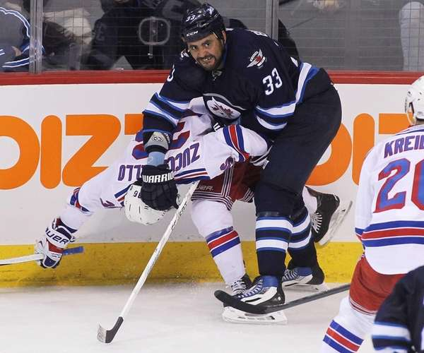 Dustin Byfuglien of the Winnipeg Jets puts pressure