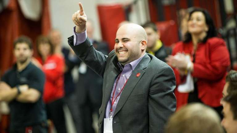 Newly hired recruiter Matt Abdelmassih cheers as St.