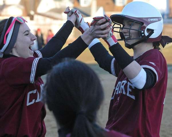 Clarke's Brooke Scherer, right, gets congratulated after delivering