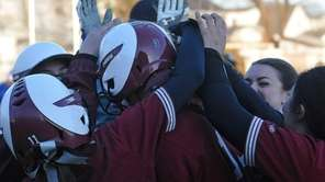 Clarke teammates mob Brooke Scherer (No. 9 on