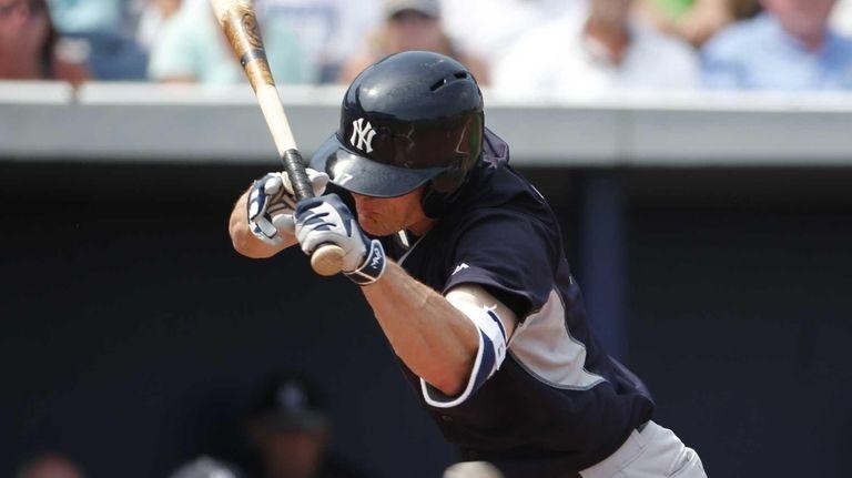 Yankees batter Brendan Ryan dodges an inside pitch