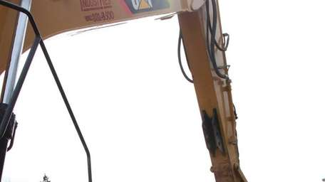 Workers put in a sewer pipe down the