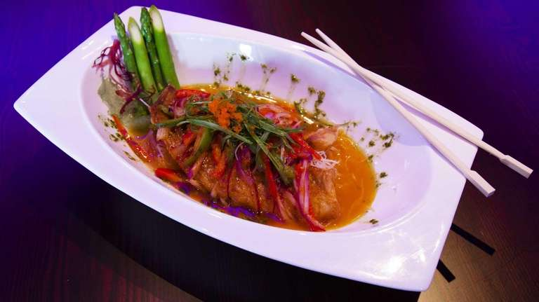 Crisp-skinned red snapper, served with Thai-basil sauce, highlights
