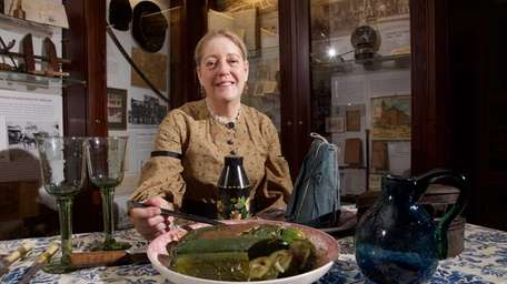 Diane Fish displays her forced cucumbers at the