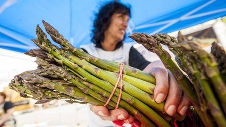 Maryann Krupski of MarGene Farms with her asparagus.