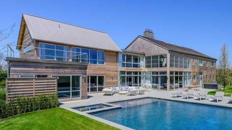 This newly-constructed, 12,000-square-foot home in South-of-the-Highway Bridgehampton combines