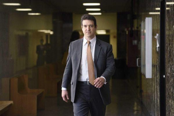 Dr. Michael Welner, a forensic psychiatrist, walks in