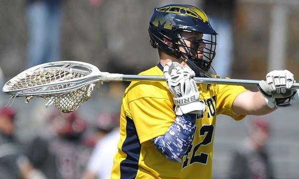 Massapequa goalie Tom Kempton makes a pass during