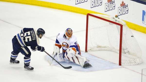 Columbus Blue Jackets' Mark Letestu scores the game-winner