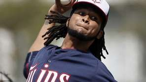 Minnesota Twins starting pitcher Ervin Santana throws batting