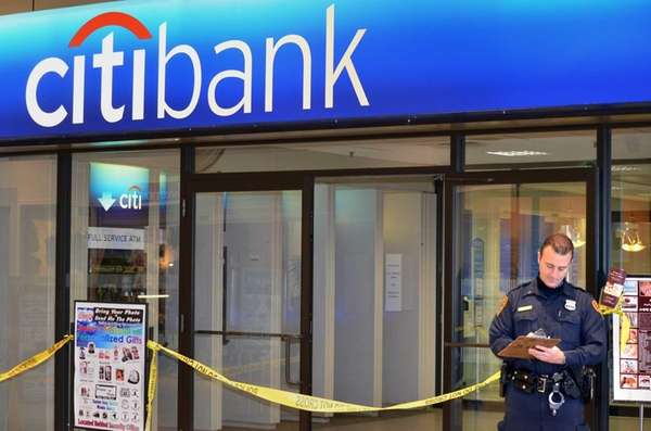 A Suffolk police officer stands outside the Citibank
