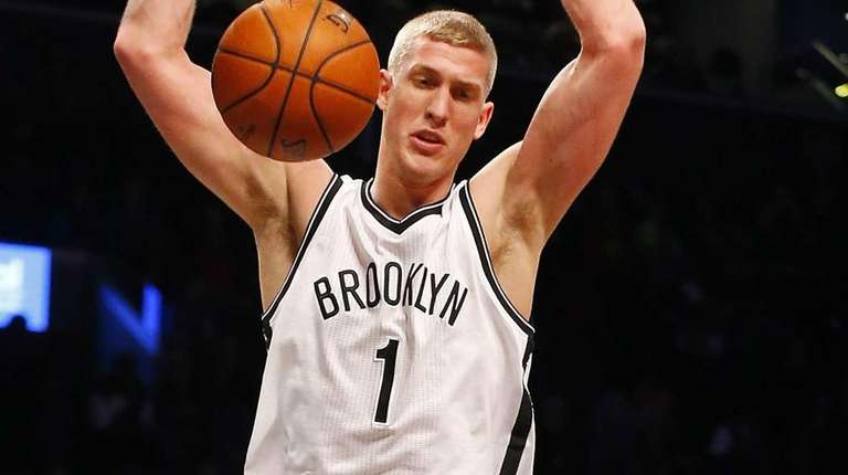 Mason Plumlee of the Brooklyn Nets dunks the