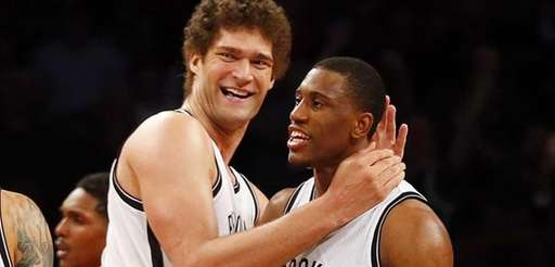 Brook Lopez, Thaddeus Young and Deron Williams of
