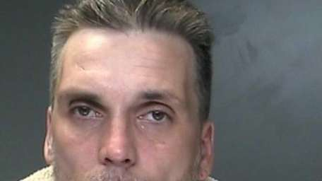 Michael Collins, 41, of Sayville, was arrested on