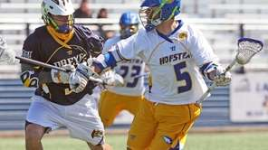 Hofstra's Sam Llinares tries to get past Drexel's