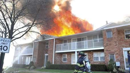 A fire sweeps through a building at the